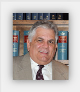 Attorney Phillip A. Passafuime
